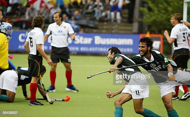 Pakistan's Shabbir Hussain and Shakeel Abbasi celebrate their 30 against Germany during their match of the Rabobank Field Hockey tournament 19 August...