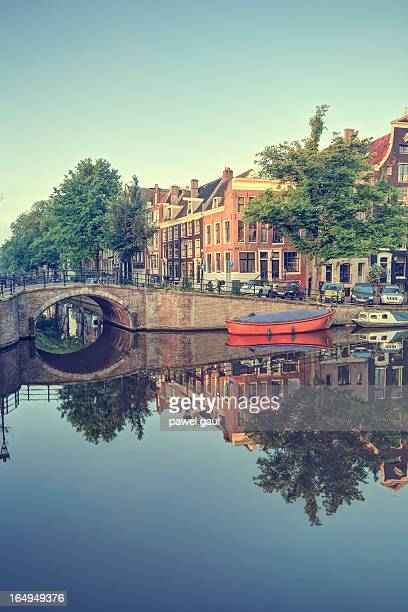 Amsterdam buildings reflected in water canal