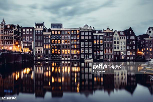 Amsterdam houses reflections at night on the water of the canal