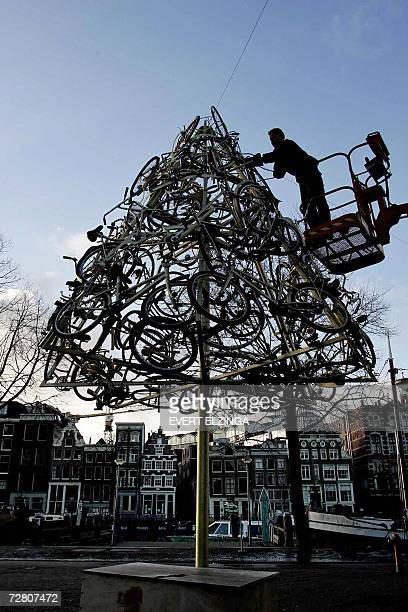 A man prepares a Christmas tree made with bicycles welded together 12 December 2006 in Stopera Amsterdam 15 trees set up like this one are part of a...