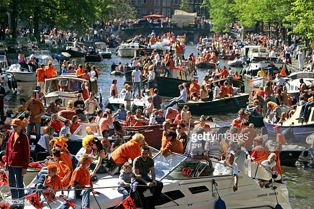 Disguised people navigate on a canal during the Dutch Queensday in Amsterdam 30 April 2007 a tradition in honour of Dutch Queen Beatrix ANP PHOTO...