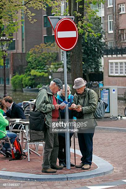 Amsterdam Netherlands Holland Europe elderly tourists consult map