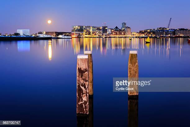 Amsterdam skyline over river