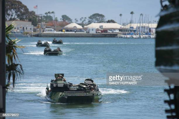 Amtrac vehicles return to shore during a homecoming reception at Camp Pendleton in Oceanside California on May 11 2017 arines and sailors from the...