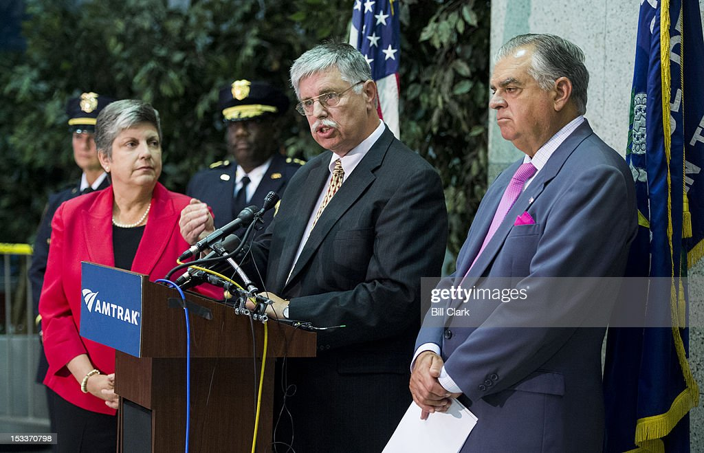 Amtrak President and CEO Joseph Boardmanto, center, flanked by Homeland Security Secretary Janet Napolitano, left, and Transportation Secretary Ray LaHood, right, speaks during the news conference on Thursday, Oct. 4, 2012, to announce a new partnership to combat human trafficking.