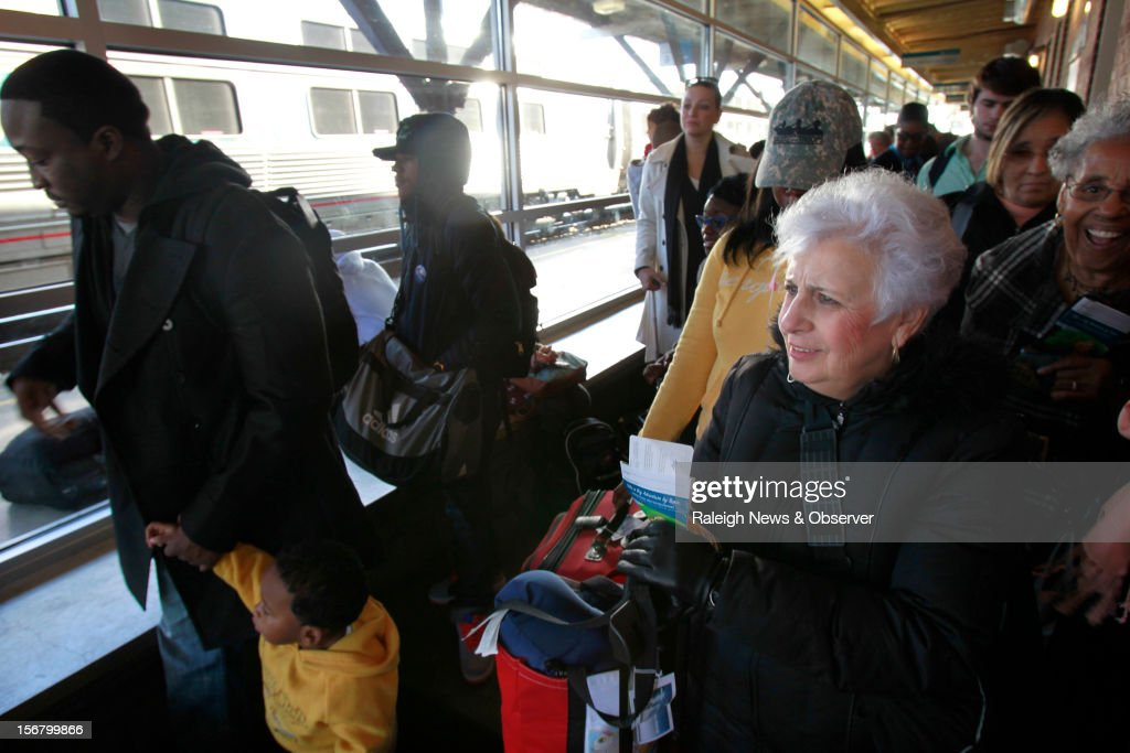 Amtrak travelers, including Marlene Loeffler, front right, watch the New-York bound train arriving at the Raleigh, North Carolina station, Wednesday, November 21, 2012. The Amtrak station was congested with travelers who were setting out on the annual Thanksgiving migration. Loeffler said she will see her son and grandchildren in Long Island, N.Y. over the weekend.