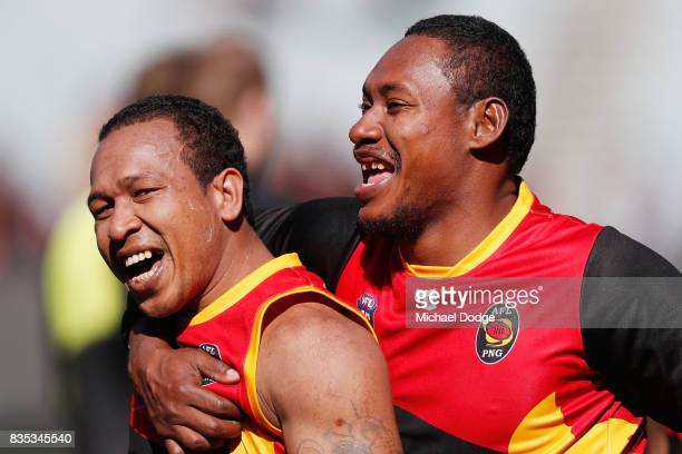 Amua Muzza Pirika of Papua New Guinea celebrates the win during the 2017 AFL International Cup Grand FInal match between New Zealand and Papua New...