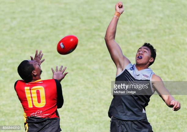 Amua Muzza Pirika of Papua New Guinea marks the ball against Joseph BAKERTHOMAS of New Zealand during the 2017 AFL International Cup Grand FInal...