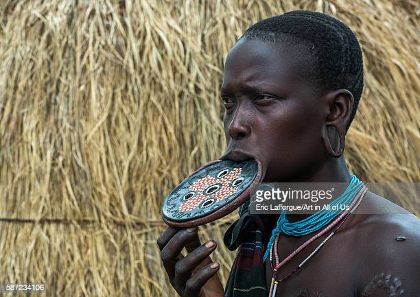 Amursi tribeswoman wearing a traditional lipplate omo valley mago park Ethiopia on March 18 2016 in Mago Park Ethiopia