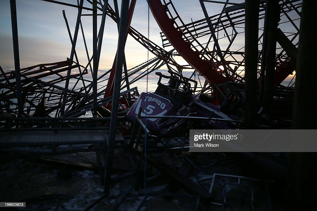 Amusement rides on the Fun Town pier are scattered and damaged by Superstorm Sandy, on November 25, 2012 in Seaside Heights, New Jersey. New Jersey Gov. Christie estimated that Superstorm Sandy cost New Jersey $29.4 billion in damage and economic losses.