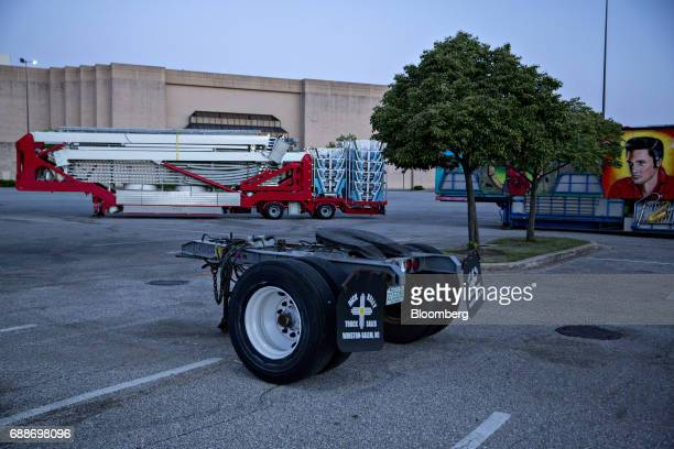 Amusement rides sit before being hauled to the next location after the Dreamland Amusements carnival in the parking lot of the Marley Station Mall in...