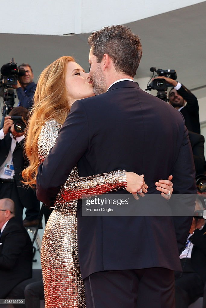 Amy Adams and Darren Le Gallo kiss during the premiere of 'Nocturnal Animals' during the 73rd Venice Film Festival at Sala Grande on September 2, 2016 in Venice, Italy.
