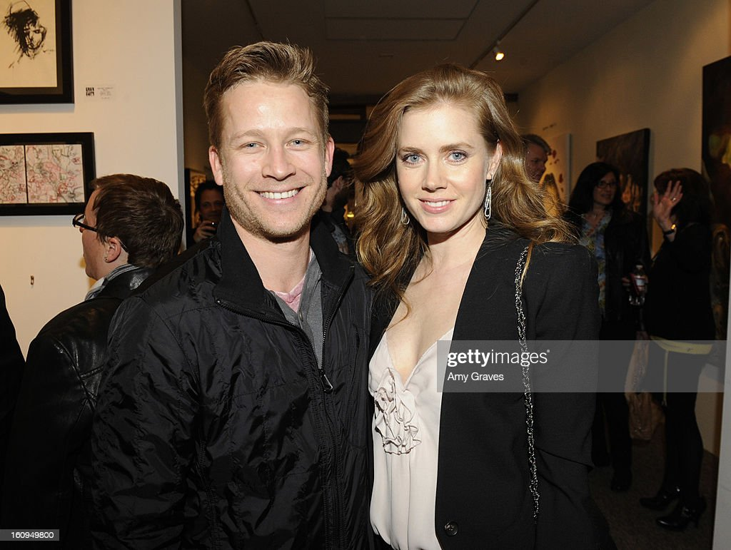 Amy Adams (R) and her brother Eddie Adams (L) attend Darren Le Gallo's 'Nothing You Don't Know' Exhibition hosted by Trigg Ison Fine Art, Amy Adams and Justin Timberlake at Trigg Ison Fine Arts Gallery on February 7, 2013 in West Hollywood, California.