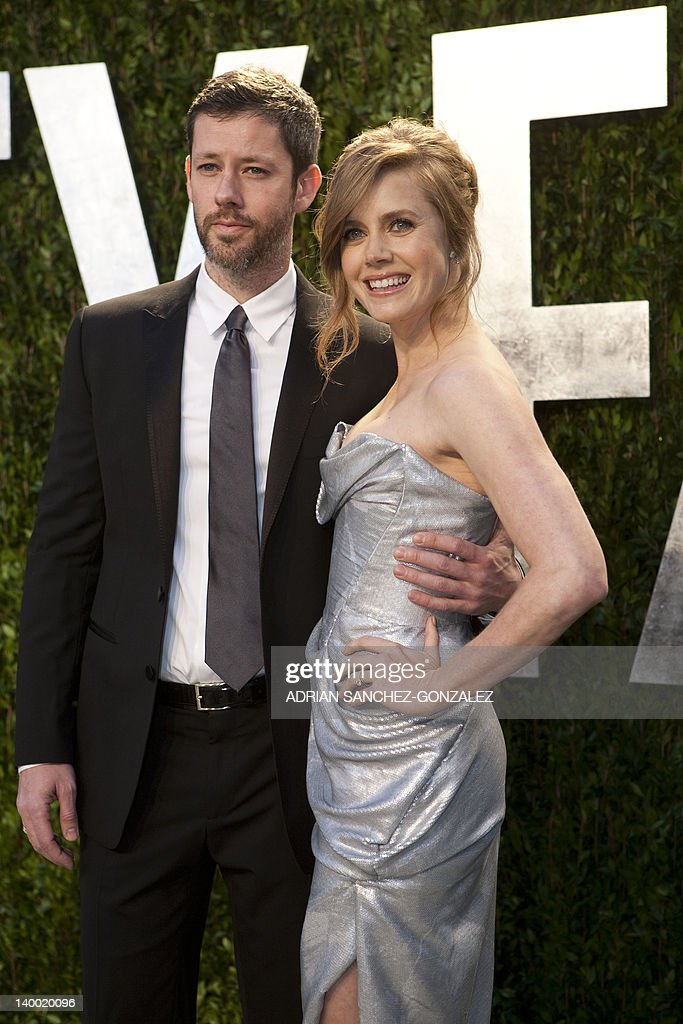 Amy Adams (R) and husband Darren Le Gallo arrive at the Vanity Fair Oscar Party, for the 84th Annual Academy Awards, at the Sunset Tower on February 26, 2012 in West Hollywood, California. GONZALEZ