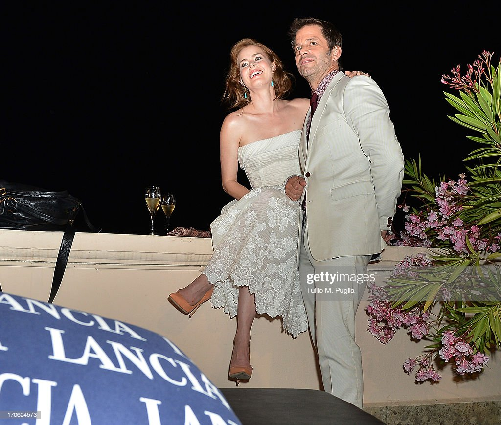 <a gi-track='captionPersonalityLinkClicked' href=/galleries/search?phrase=Amy+Adams&family=editorial&specificpeople=213938 ng-click='$event.stopPropagation()'>Amy Adams</a> and <a gi-track='captionPersonalityLinkClicked' href=/galleries/search?phrase=Zack+Snyder&family=editorial&specificpeople=834481 ng-click='$event.stopPropagation()'>Zack Snyder</a> attend the Lancia Cafe during the Taormina Filmfest 2013 on June 15, 2013 in Taormina, Italy.