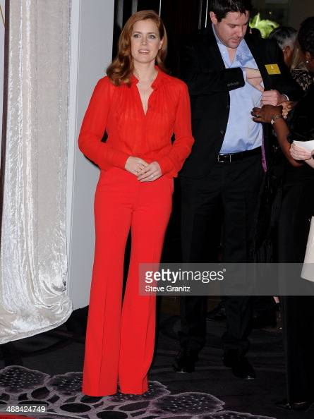 Amy Adams arrives at the 86th Oscars Nominee Luncheon at The Beverly Hilton Hotel on February 10 2014 in Beverly Hills California