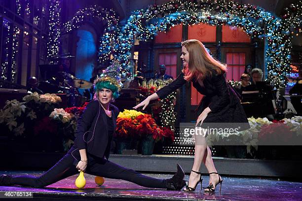 LIVE 'Amy Adams' Episode 1672 Pictured Kristen Wiig and Amy Adams during the Christmas Monologue on December 20 2014