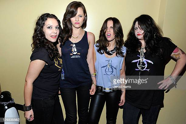 Amy Cesari Brett Anderson Allison Robertson and Maya Ford of The Donnas arrive at the Original Penguin 5th Anniversary Party at Original Penguin on...