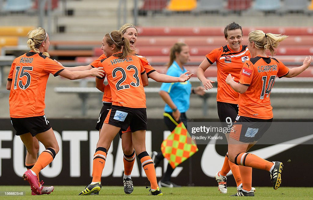 Amy Chapman of the Roar celebrates with team mates after scoring a goal during the round six W-League match between the Brisbane Roar and the Melbourne Victory at the Queensland Sport and Athletics Centre on November 24, 2012 in Brisbane, Australia.