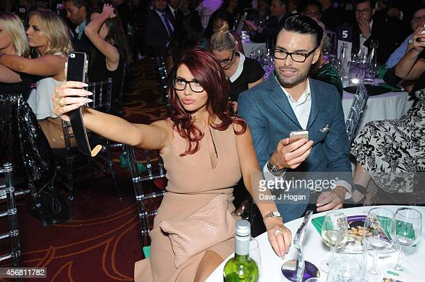 Amy Childs and Rylan Clark attends the Spectacle Wearer Of the year Awards at 8 Northumberland Avenue on October 7 2014 in London England