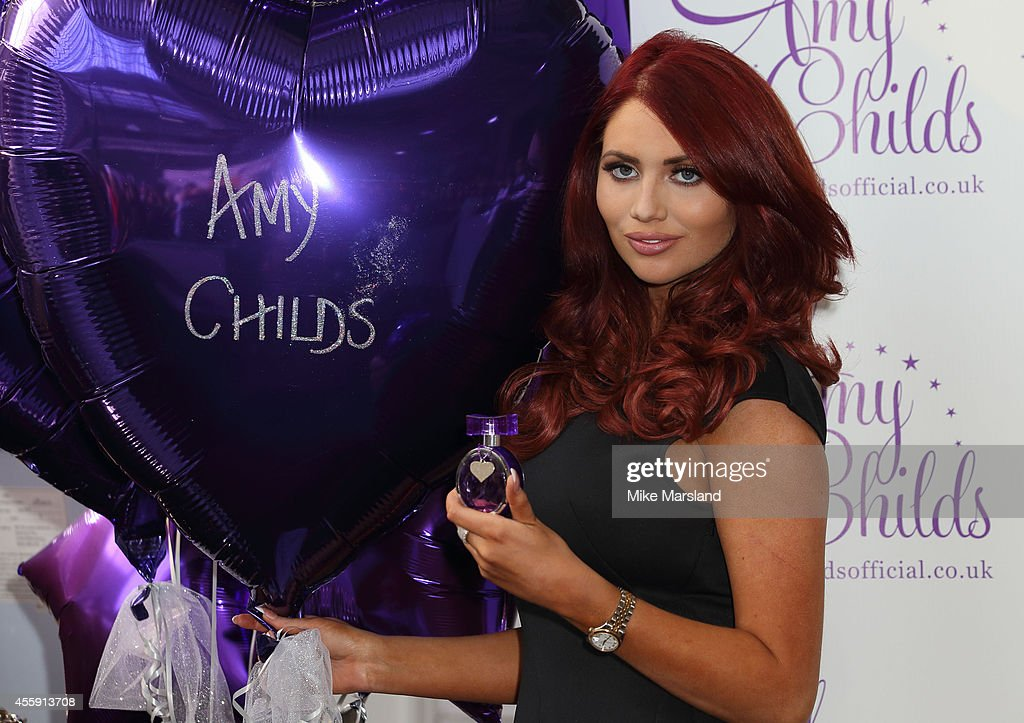 Amy Childs attends a photocall at The Beauty Show to launch her new perfume at Olympia Exhibition Centre on September 22 2014 in London England