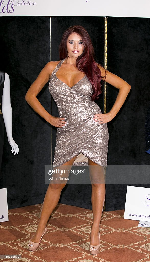 Amy Childs attends a photocall to launch to Amy Childs SS14 collection at Melia White House Hotel on September 11 2013 in London England