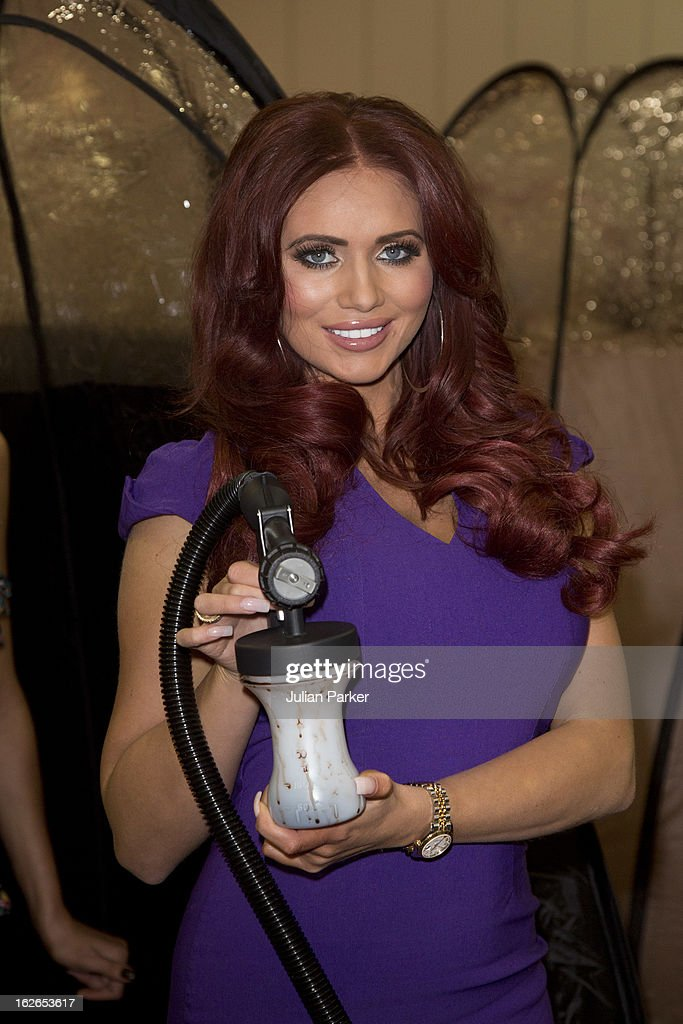 <a gi-track='captionPersonalityLinkClicked' href=/galleries/search?phrase=Amy+Childs&family=editorial&specificpeople=7306054 ng-click='$event.stopPropagation()'>Amy Childs</a> attends the Professional Beauty show at ExCel on February 25, 2013 in London, England. The reality TV star took part in a world record attempt with other spray tanners to perform the most simultaneous spray tans in one location, although the Guinness world record was not achieved, the tanners took the UK record.