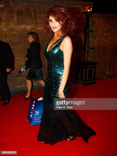 Amy Childs departs the 60th Birthday Celebration of Richard Desmond at Old Billingsgate Market on December 8 2011 in London England