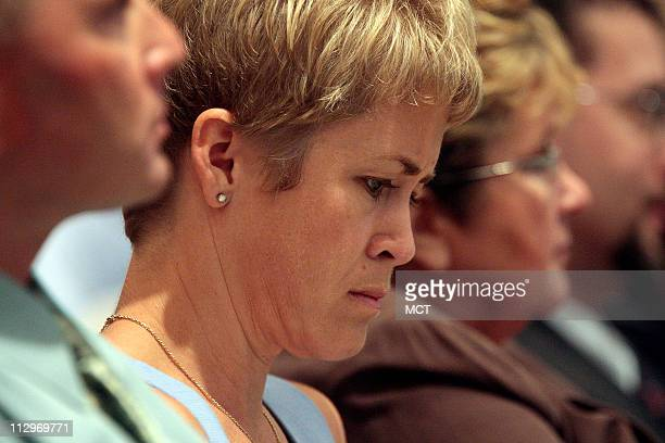 Amy Clay the wife of pilot Jeff Clay listens to findings during a NTSB meeting on the Lexington Kentucky crash investigation on Comair Flight 5191...
