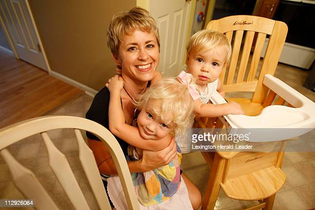 Amy Clay wife of Comair pilot Jeff Clay talks about her husband with her children Shelby left and Sarah right in her home in Burlington Kentucky...