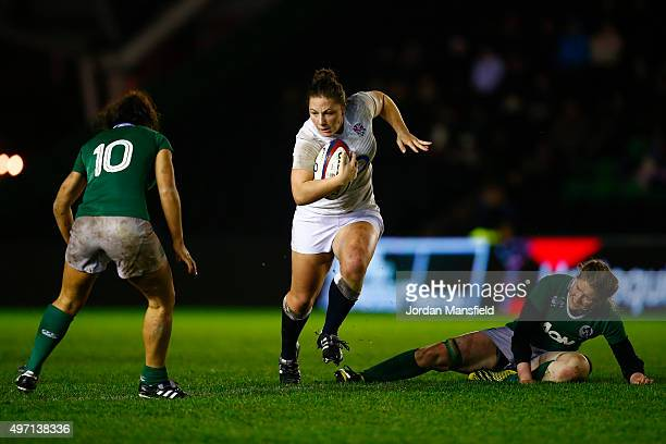 Amy Cokayne of England avoids a tackle by Heather O'Brien and Sene Naoupu of Ireland during the Women's International match between England v Ireland...