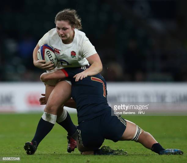 Amy Cokayne of England is tackled by Romane Menager of France during the Women's Six Nations match between England and France at Twickenham Stadium...