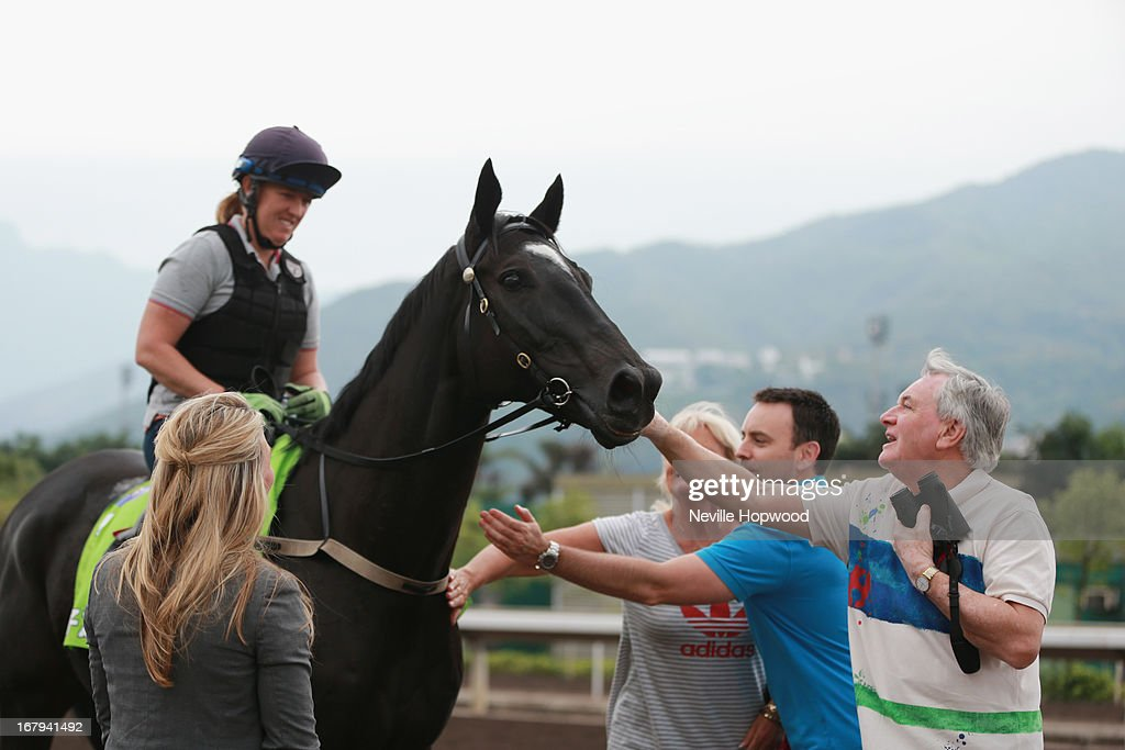 Amy Doran riding King Mufhasa is greeted by the owners during a trackwork session at Sha Tin racecourse on May 3, 2013, ahead of the Champions Mile this Sunday in Hong Kong, Hong Kong.