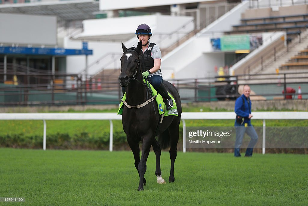 Amy Doran riding King Mufhasa watched by trainer Bruce Wallace during a trackwork session at Sha Tin racecourse on May 3, 2013, ahead of the Champions Mile this Sunday in Hong Kong, Hong Kong.