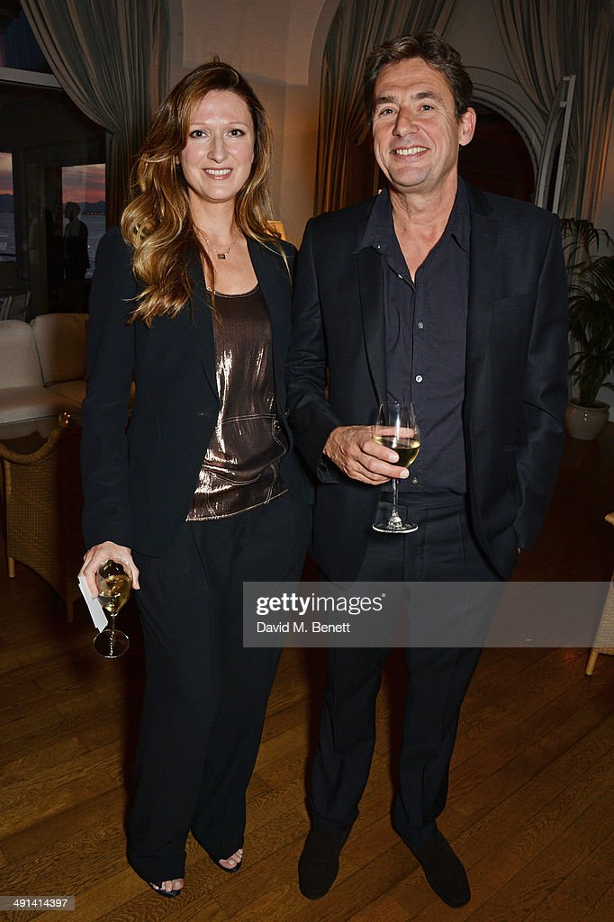 Amy Gadney and Tim Bevan attend the annual Charles Finch Filmmakers Dinner during the 67th Cannes Film Festival at Hotel du CapEdenRoc on May 16 2014...