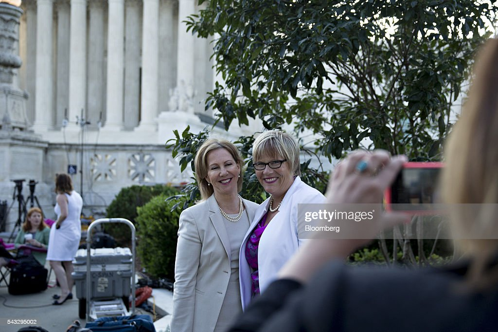 Amy Hagstrom Miller, founder and chief executive officer of Whole Womans Health, right, and Nancy Northup, president of Center for Reproductive Rights, stand for a photograph while waiting in line before rulings outside the U.S. Supreme Court in Washington, D.C., U.S., on Monday, June 27, 2016. A divided U.S. Supreme Court struck down a Texas law that had threatened to close three-quarters of the states abortion clinics by putting new requirements on facilities and doctors. Photographer: Andrew Harrer/Bloomberg via Getty Images