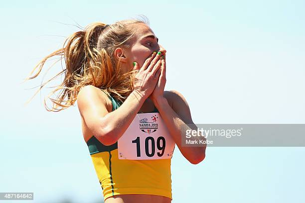 Amy HardingDelooze of Australia celebrates after winning the girls 1500m final during the athletics competition at the Apia Park Sports Complex on...