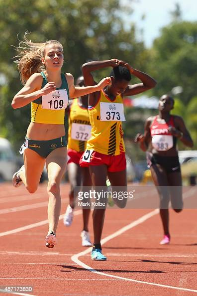 Amy HardingDelooze of Australia lunges for the line to defeat Peruth Chemutai of Uganda in the girls 1500m final during the athletics competition at...