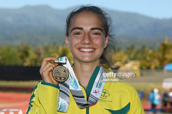 Amy HardingDelooze of Australia poses with her gold medal after winning the girls 1500m final during the athletics competition at the Apia Park...