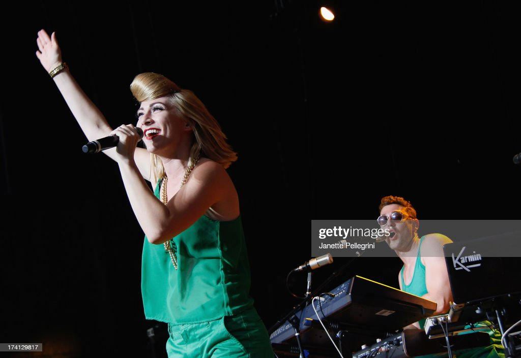 Amy Heidemann and Nick Noonan of Karmin perfom at Nikon at Jones Beach Theater on July 20, 2013 in Wantagh, New York.