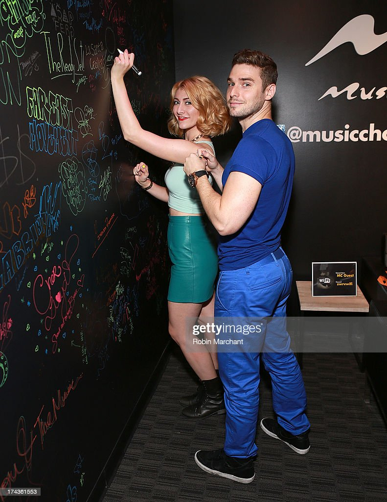 Amy Heidemann (L) and Nick Noonan of Karmin visit at Music Choice on July 24, 2013 in New York City.