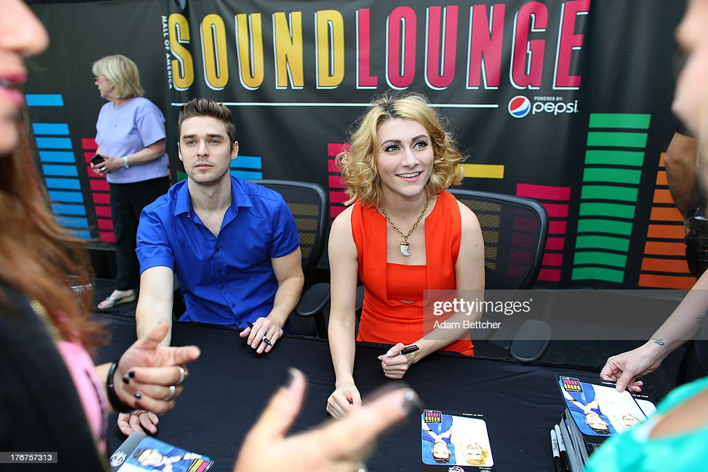 Amy Heidemann and Nick Noonan of the band Karmin greet fans at the KDWB soundlounge on August 16, 2013 at Mall of America in Bloomington, Minnesota.