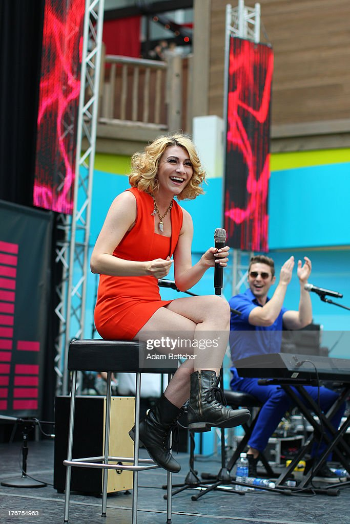 Amy Heidemann and Nick Noonan of the band Karmin perform at the KDWB soundlounge on August 16, 2013 at Mall of America in Bloomington, Minnesota.