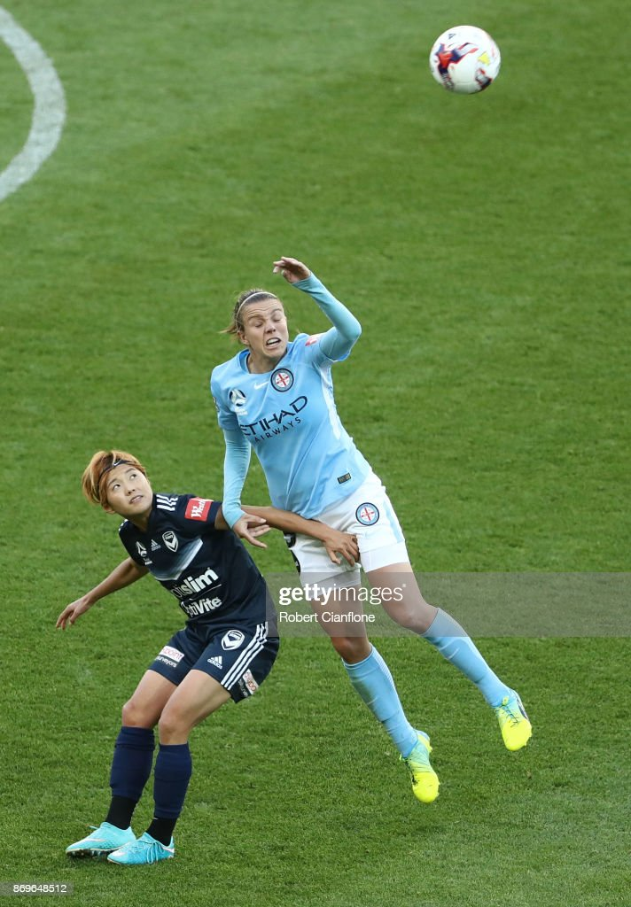 Amy Jackson of Melbourne City and Jeon Ga Eul of the Victory compete for the ball during the round two W-League match between Melbourne City FC and Melbourne Victory at AAMI Park on November 3, 2017 in Melbourne, Australia.