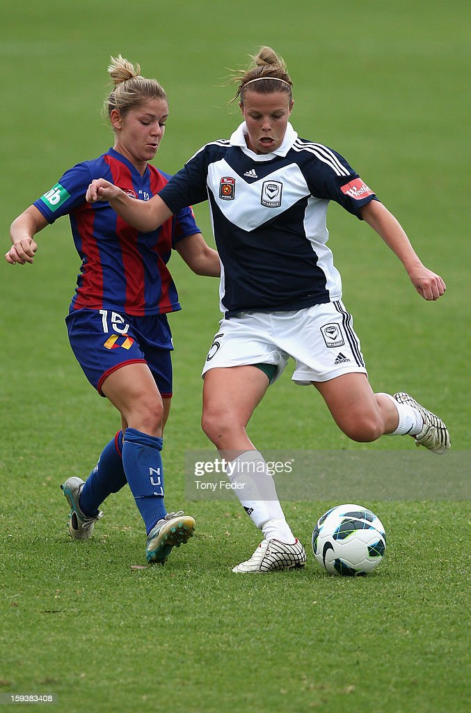 Amy Jackson of the Melbourne Victory and Alisha Foote of the Newcastle Jets contest the ball during the round 12 W-League match between the Newcastle Jets and the Melbourne Victory at Wanderers Oval on January 13, 2013 in Newcastle, Australia.