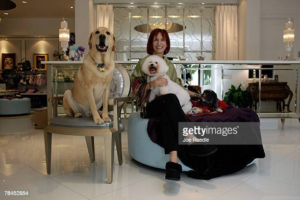 Amy Jo Birkenes part owner of Chateau Poochie poses with a dog in the lobby of the luxury hotel for dogs and cats December 13 2007 in Pompano Beach...
