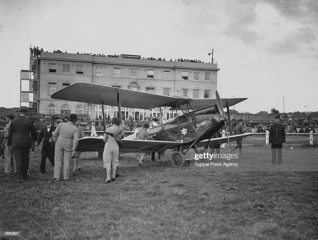 Amy Johnson returns to England following her record-breaking 19 day solo flight from Britain to Australia. Her De Havilland Gipsy Moth 'Jason' attracted much attention back at Croydon airport.
