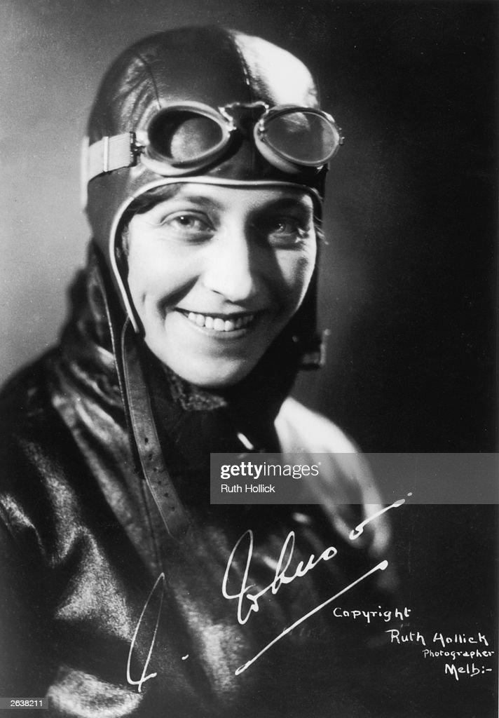 Amy Johnson (1903 - 1941) the English pioneer aviator, later married to Captain Jim Mollison, in her aviators costume, with her signature.