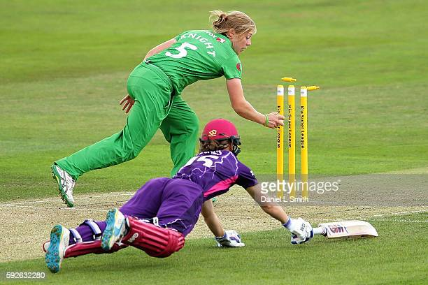 Amy Jones of Loughborough Lightning is run out by Heather Knight of Western Storm in their semifinal clash during the Kia Super League Finals Day at...