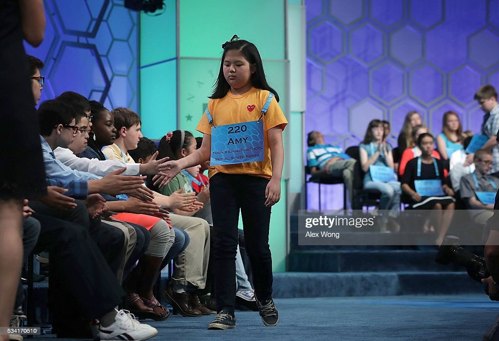 Amy Jung of Busan, South Korea, leaves the stage after she misspelled her word in round two of the 2016 Scripps National Spelling Bee May 25, 2016 in National Harbor, Maryland. Students from across the country gathered to compete for the top honor at the annual spelling championship.